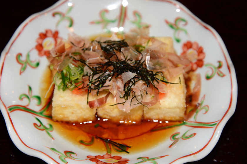 Fried tofu in broth