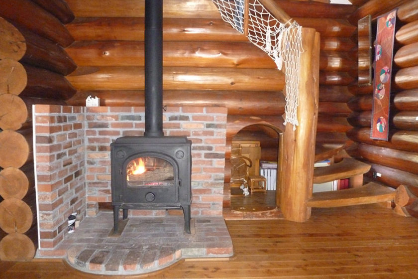 The wood-burning stove heats the whole house
