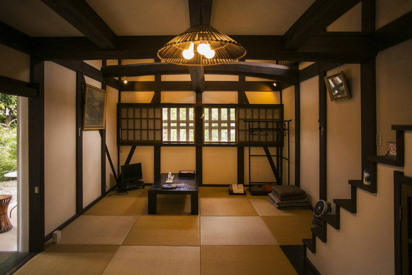 The interior of the former storehouse, converted to a modern Japanese guesthouse