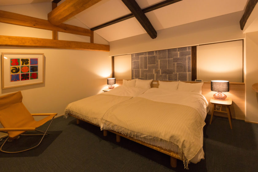 A spacious relaxing bedroom with beautiful beams on the ceiling